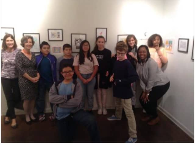 Students from the ASPIRE arts program show off their artwork at a reception at the Rowayton Arts Center.