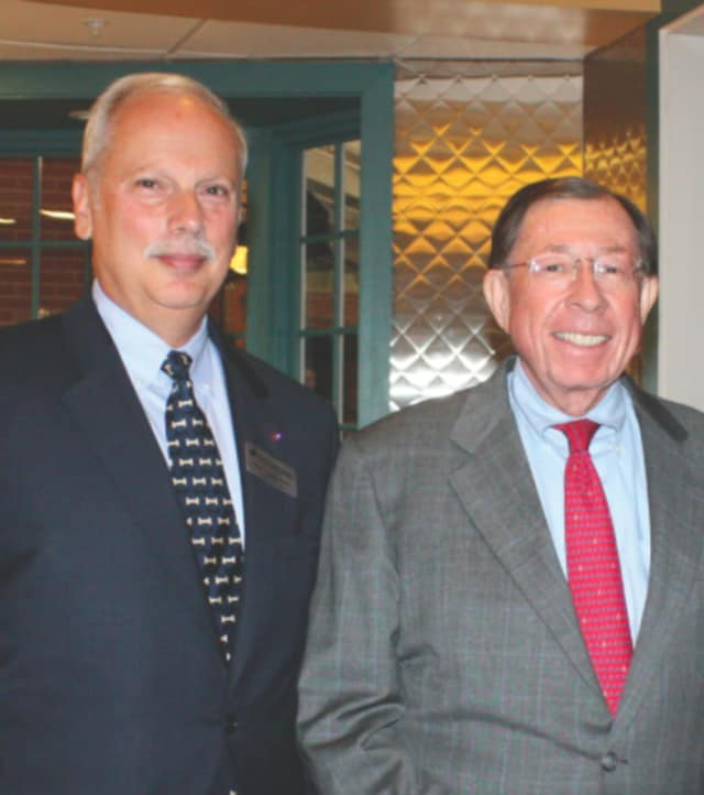 Harry T. Rein, left, and Reyno Giallongo, Jr., chairman of the board and CEO of First County Bank and president of First County Bank Foundation.
