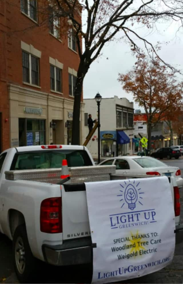 Holiday lights being put up on Greenwich Avenue
