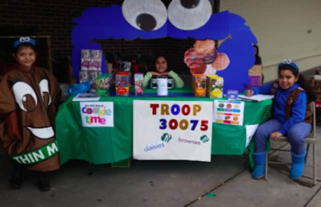 A Bridgeport Girl Scout sells cookies. The annual Girl Scout Cookie sale has begun in Connecticut.