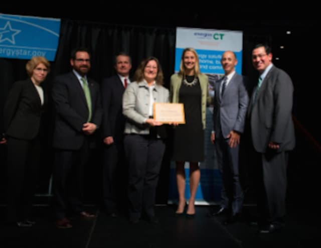 Stamford officials receive the city's Clean Energy Award,