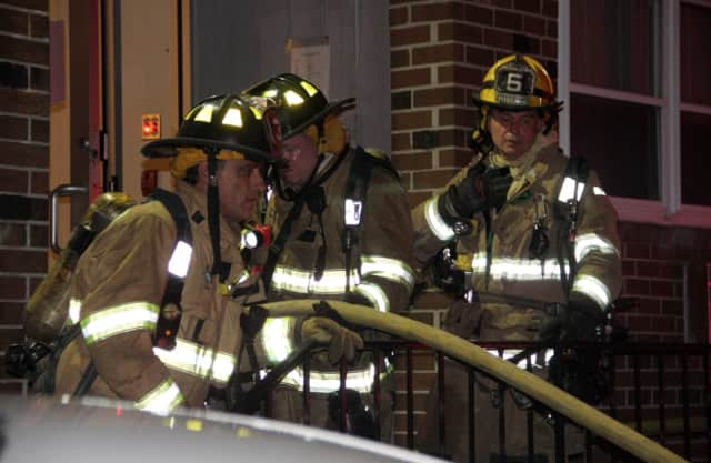 Stamford firefighters respond to a fire at 637 Cove Road in Stamford on Sunday night.