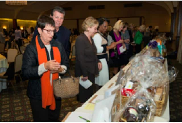 Participants take part in the silent auction at the New Covenant Center's Harvest Table Fundraiser.