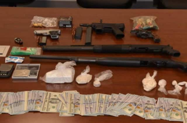 Weapons, cash and drugs gathered in the investigation that saw 30 people arrested for selling heroin and cocaine.