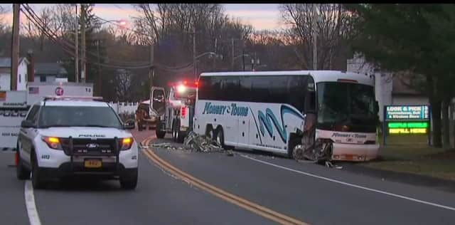 Ramapo Police said that a driver that fled from an accident scene after slamming into a tour bus has turned himself in.