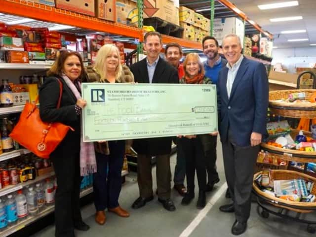 The Stamford Board of Realtors presented a check for $1,500 to the Food Bank of Lower Fairfield County. The Realtors raised the money through a guest bartender event at Sign of The Whale in Stamford.