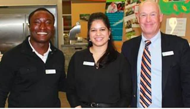 """Banji Iyun and Sherlene Rodriguez, vice chairs of Norwalk's Family & Children's  Agency's Junior Board of Advisors; and Robert Cashel, right, the agency's president and CEO, celebrate the success of the annual """"A Taste of Fairfield County"""" event."""