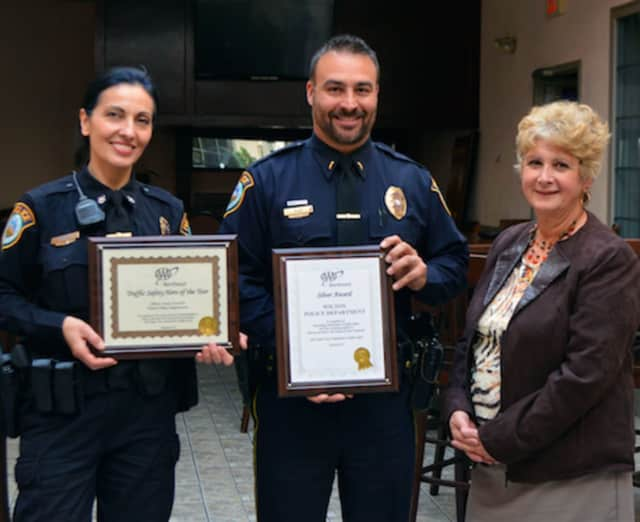 At AAA's 6th Annual Community Traffic Safety Awards lunch recently at Testo's in Bridgeport, Public Affairs Manager Fran Mayko, right, presented awards to Officer Anna Tornello, left, and Lt. Robert Kluk.