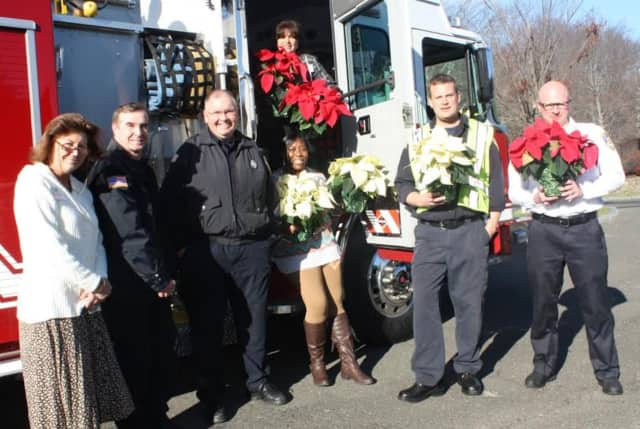 New Canaan Fire Department delivered poinsettas to help celebrate the holidays at Waveny LifeCare in New Canaan.