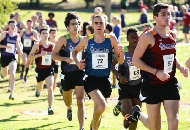 Eric van der Els, a senior from Brien McMahon in Norwalk (no. 55) makes his move late in Saturday's Foot Locker national cross country championships in San Diego.