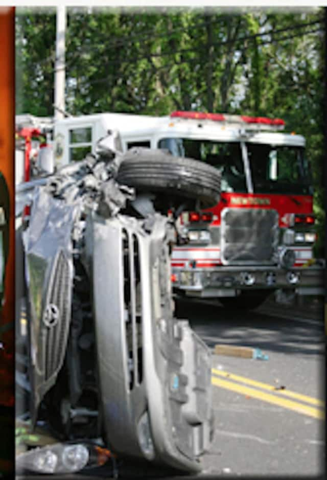 The Newtown Fire Department helped extricate a person trapped in a tractor-trailer accident on I-84 on Tuesday.