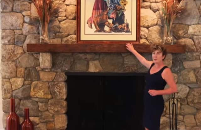 Muffin Dowdle, a Realtor for Ginnel Real Estate, uses video shown on NBC in New York to showcase some of her listings.