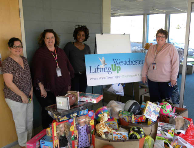 Berkeley College collected 137 toys for children at Lifting Up Westchester, which is based in White Plains. See story for IDs.