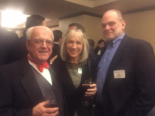 Paul Timpanelli, left, of the Bridgeport Regional Business Council meets guests at the holiday dinner.