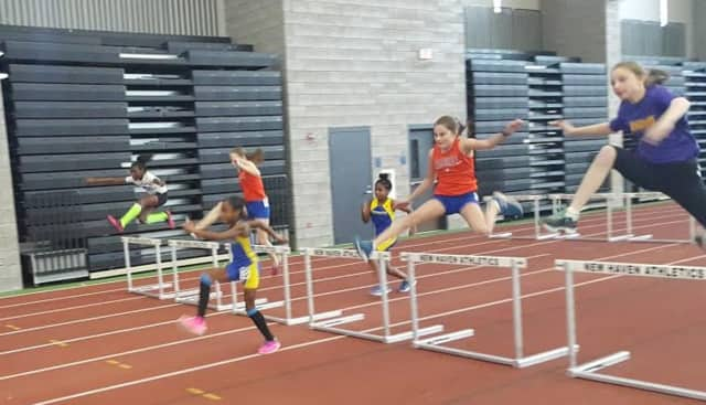 Danbury Flyers runners compete a recent meet in New Haven.