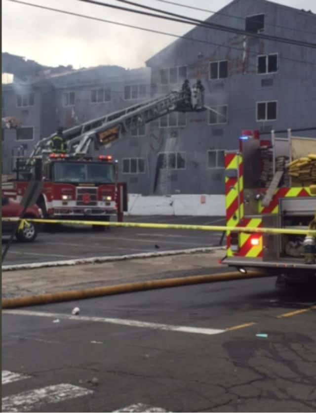 Firefighters work to put a fire that destroyed a condo complex on Charles Street, leaving more than 100 people homeless.