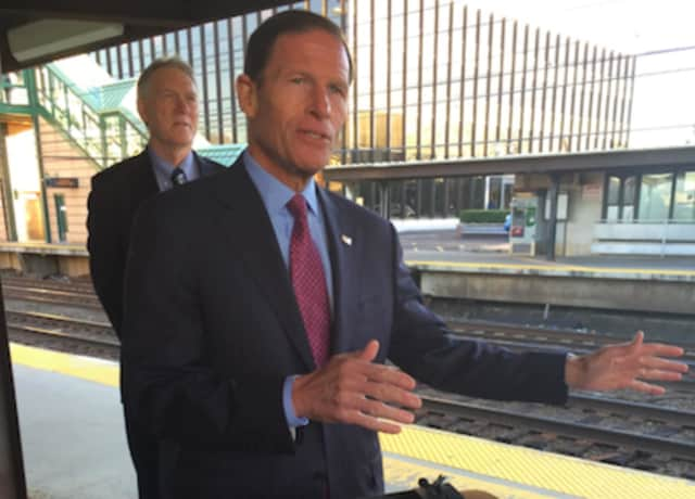 U.S. Sen. Richard Blumenthal makes a point about the restoration of the commuter tax benefit at the Greenwich Train Station while John Hartwell looks on.