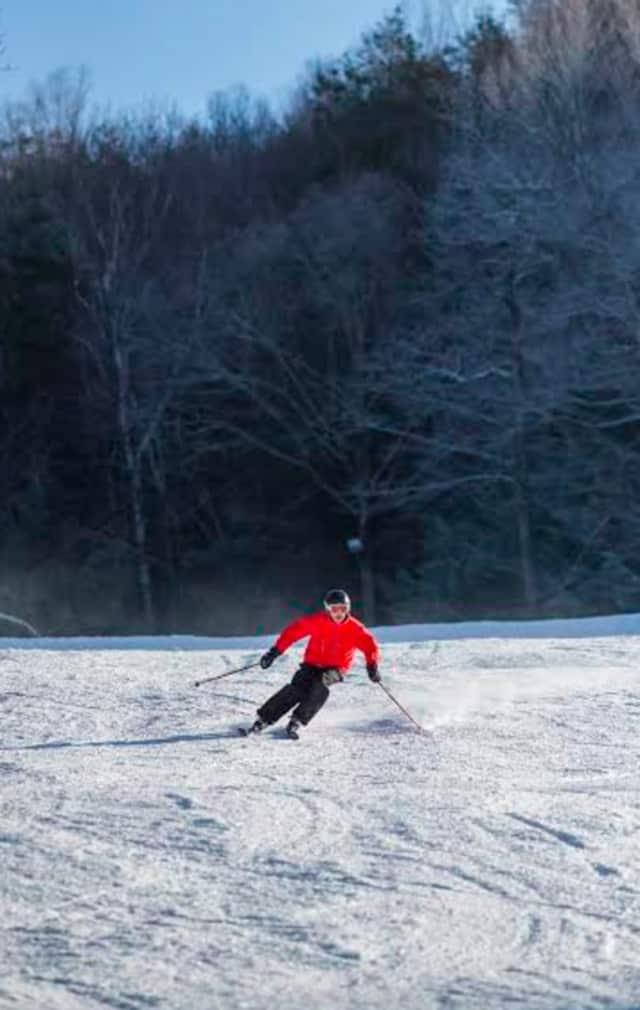 A skier glides down the mountain Friday at Ski Sundown in New Hartford.