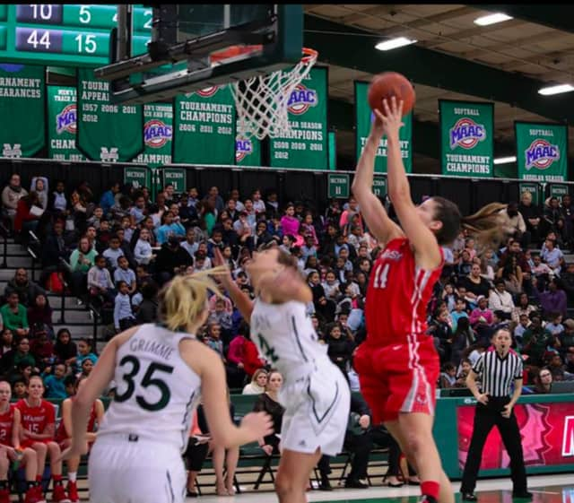 Tori Jarosz, a senior from Cortlandt Manor, scores for Marist against Manhattan on Tuesday. She scored a career-high 27 points in Marist's 79-73 win.