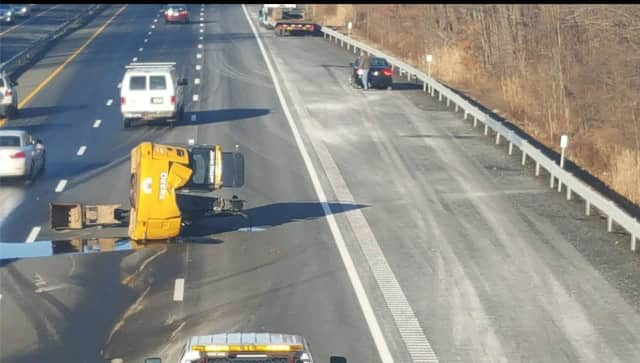 The 9:30 a.m. accident involved an excavator being trailered and resulted in stop-and-go delays to Exit 14A (northbound Garden State Parkway connector).