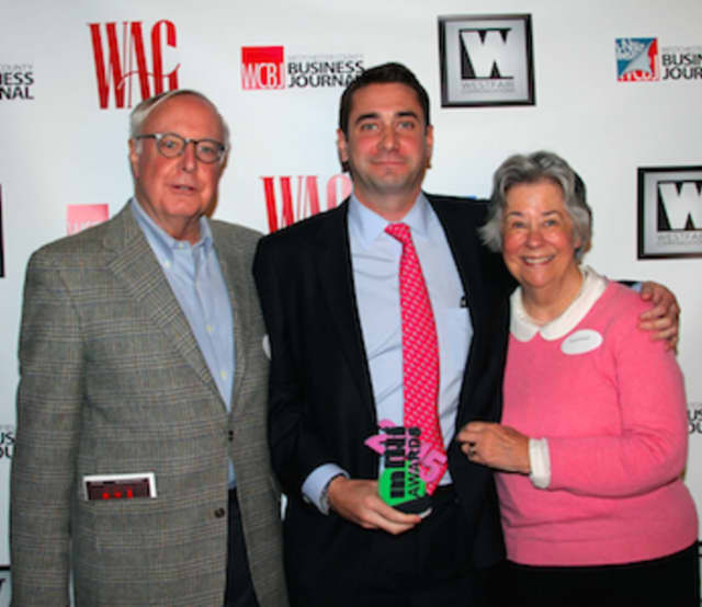 Shown from left are Edward Mundy, award recipient, Nat Mundy and Sarah Mundy.