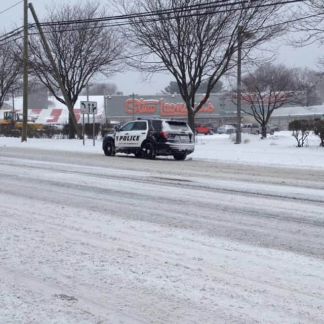 Snow covers the roadway on Route 1 in Norwalk on Saturday.
