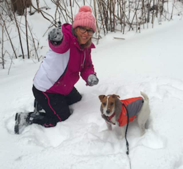 Paula Anger with her dog Lucky enjoying the snow in Stamford during last month's big storm.
