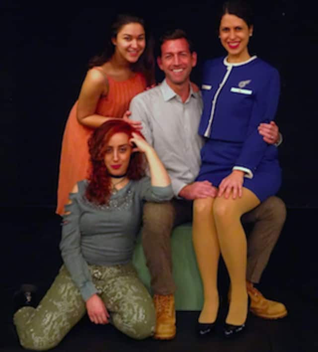 """Company,"" is a musical comedy that explores love, relationships and intimacy. Shown: Bobbie is John Congdon, with, Anna Oxman, Rachel Schulte and Lisa Dahlstrom."