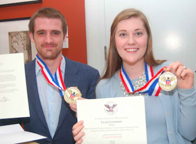 Cameron Driscoll and Leah Common receive Gold President's Volunteer Service Awards for their work with the Seaside Center in Greenwich Point Park summer programs.