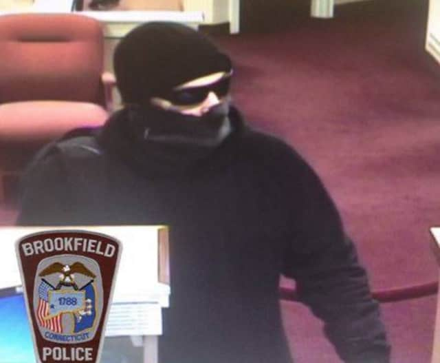 A man described as a 5-foot-10 white male dressed all in black clothing robbed a bank in Brookfield on Monday afternoon.