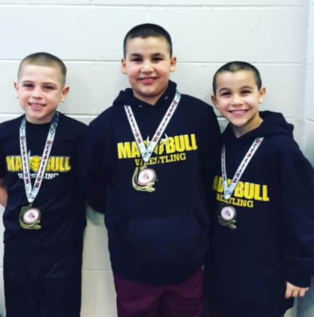 Jacob Gonzales, Jason Singer and Nicky Singer of the Mad Bull Youth Wrestling Squad in Norwalk.