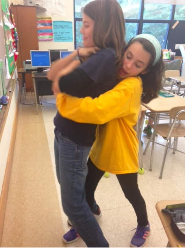 Sixth-grade students learned how to perform the Heimlich maneuver during a demonstration in health teacher Luann Ricciardi's class.