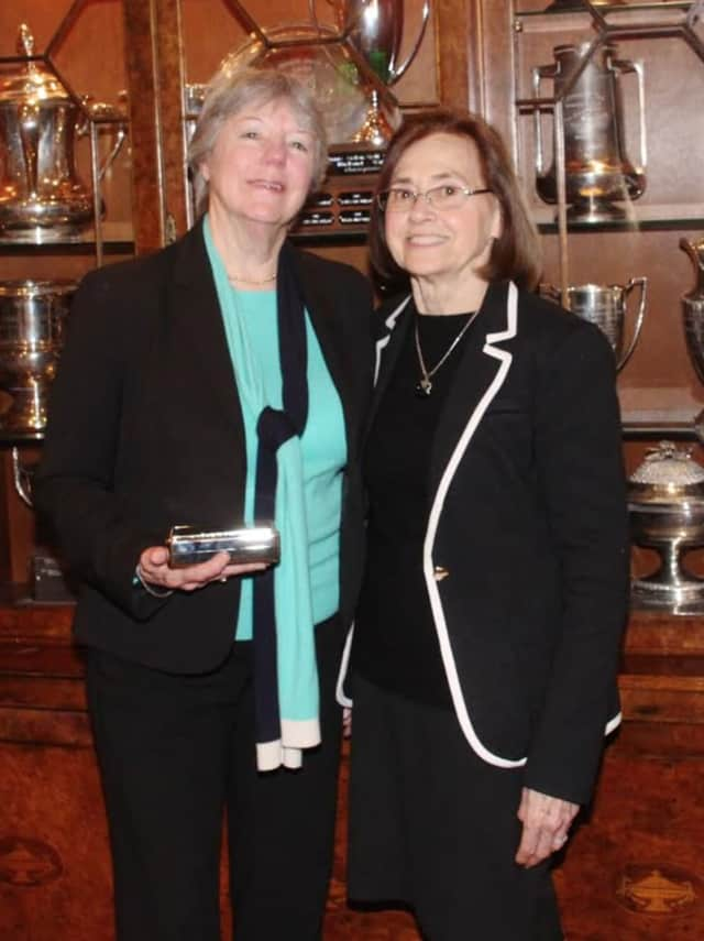 Sally Parris (left) receives Hall of Fame Induction Award from Carolyn Anderson (right).