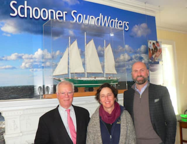 Dr. Leigh Shemitz, center, president of SoundWaters, flanked by board chairmen Tom O'Connell, left, of the Young Mariners Foundation and Scott Mitchell of SoundWaters at the SoundWaters Coastal Education Center on Cove Island.