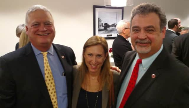 John Tolomer, left, President and Chief Executive Officer of The Westchester Bank, joins Michael DiSante, right, at the grand opening celebration last week. They are shown with Jill Greenspan of Silverman Realty.