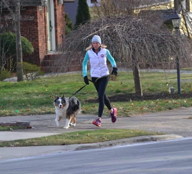 Anne McDonnell takes a dog for a run in Ridgewood.