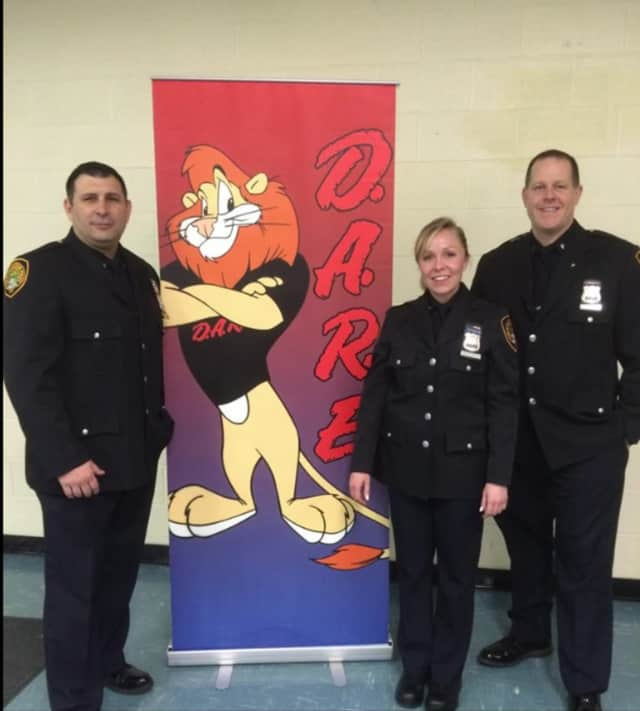 Orangetown police officers Brandon Myers, Elizabeth Muckell and Daniel Ryan are the new DARE officers for the department. They will work with local schools to present the program.