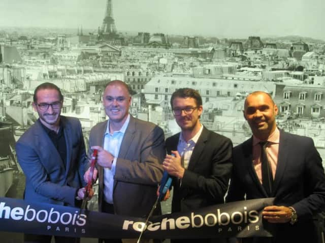 Paramus Mayor Richard LaBarbiera, second from left, with local and international representatives of Roche Bobois.