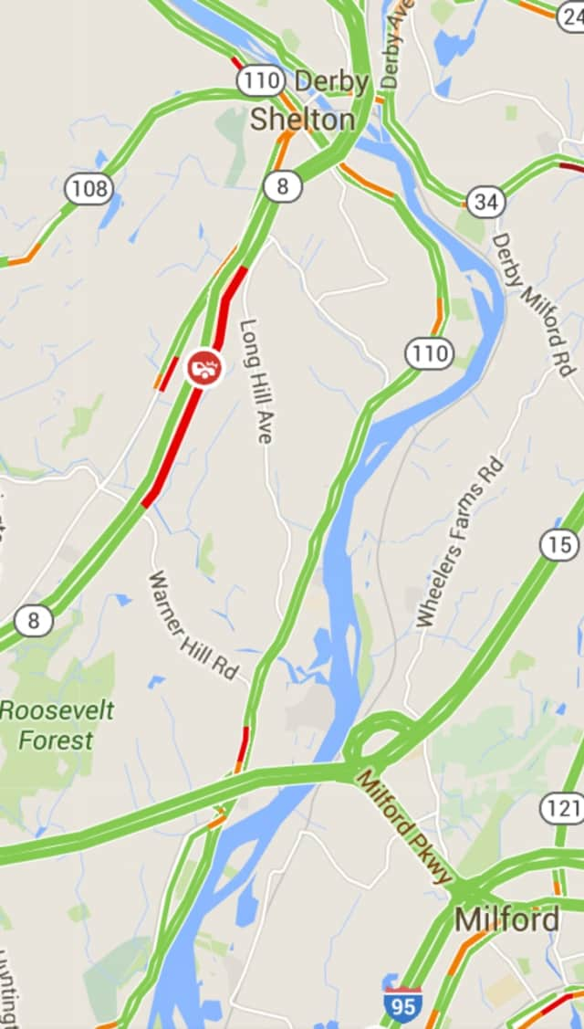 There is a nearly 3-mile backup on Route 8 in Shelton due to a one-car crash.