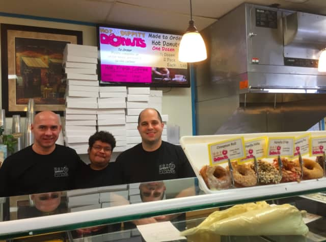 Jose Abadia, Giraldo Gil and owner Evan Liaskos at Bagels on Hudson.