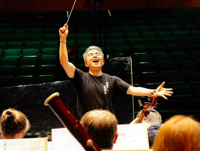 Conductor Jun Nakabayashi rehearses the Festival Orchestra for Hoff-Barthelson Music School.