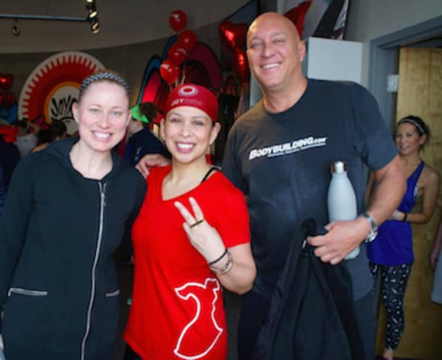 Selina Santos, center, co-executive producer of the Steve Wilkos Show, which films at NBCUniversal's studios in Stamford, pictured with Wilkos and his wife, Rachelle.