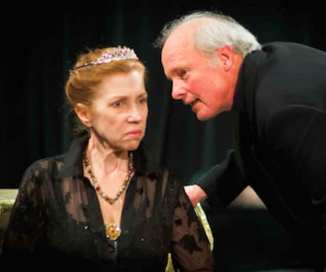 Sir Robert Cecil, played by John O'Hern, consults with Queen Elizabeth I, played by Emilie Roberts, in the DAC Stage production of Shakespeare and the Heart's Desire.