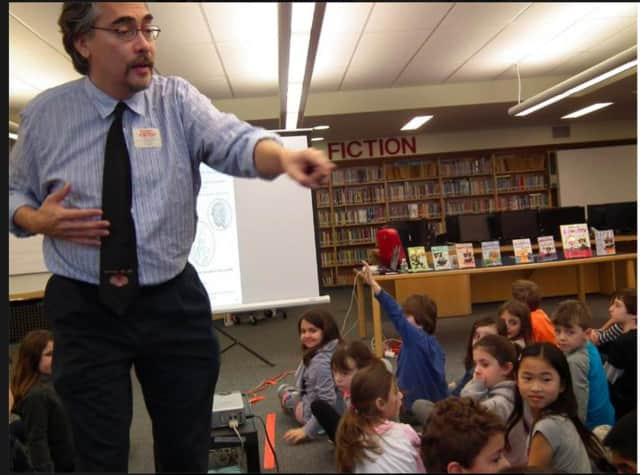 "New York Times best-selling ""Bad Kitty"" author and illustrator Nick Bruel speaks with second- and third-grade students from Todd Elementary School in Briarcliff Manor."