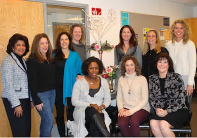 Wilton Library's gala committee (standing from left) Elaine Tai-Lauria, Kathryn Buis, Tamara Kalin, Betsy Hoffmann, Kathryn Groves, Teresa Waldron and Michele Ferguson Nichols and (seated from left) Priscilla Thors, Michele Klink and Janel Cassara.