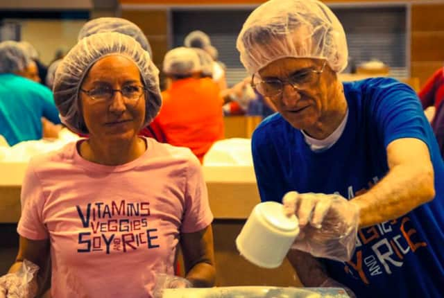 Help pack meals for underserved people at Pascack Hills High School.