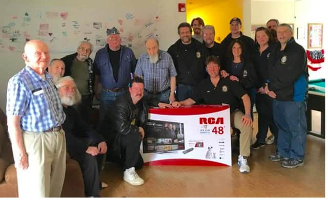 """Members of the Sons of the American Legion Post 1080 in Mahopac donated a 48"""" Smart LED TV to the veterans at the Putnam County Vincent Leibell Veterans Home in Carmel."""