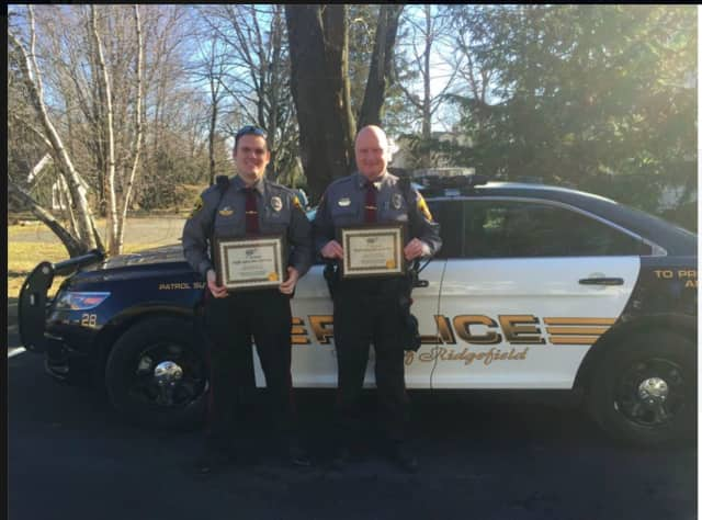From left, Officers Terry Hawaux and Charlie Ekstrom received the AAA Traffic Safety Award for their outstanding work regarding traffic safety in the Town of Ridgefield in 2015.