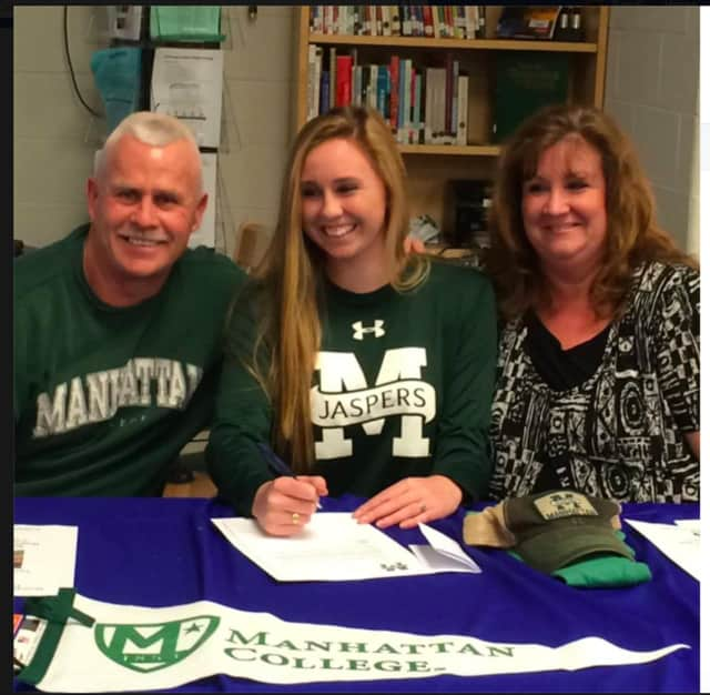 Megan O'Connor signs commitment letter to play soccer for Manhattan College.