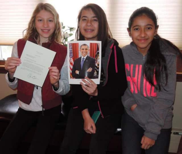 Elizabeth Sagi, Angela Kohout and Madeline Murillo with a signed letter from President Barack Obama.